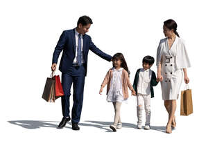cut out asian family with two kids and shoppping bags walking