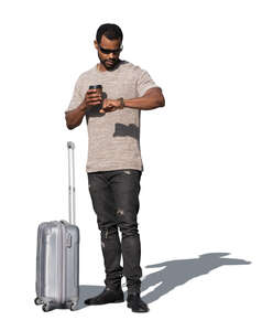 cut out man with a suitcase standing and looking at his watch