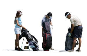 three cut out people preparing to play golf