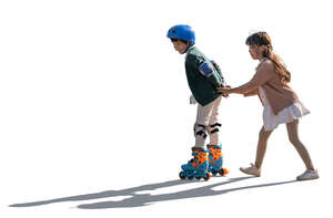 two cut out backlit kids roller skating