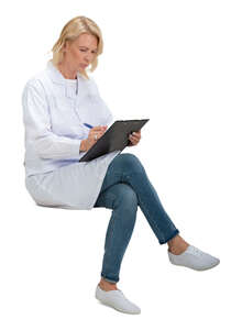 cut out female doctor sitting and writing