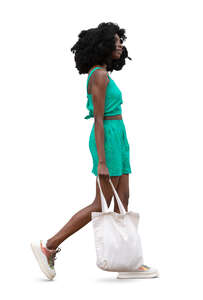 cut out young black woman walking casually