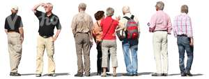 eight elderly people standing and looking around