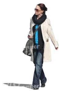 woman wearing a spring coat walking