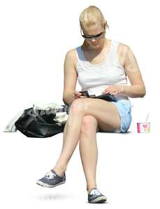 woman in shorts sitting