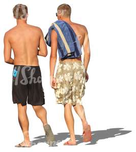 two men in shorts walking in the beach