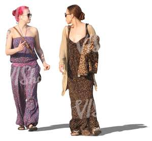two women in summer dresses walking and talking