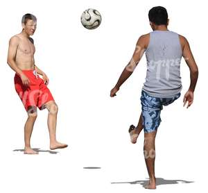 two men playing football at the beach