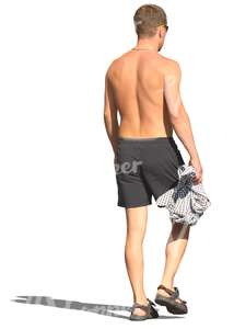 man in swimming pants walking