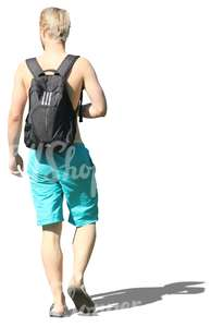 blond man in swimming pants walking