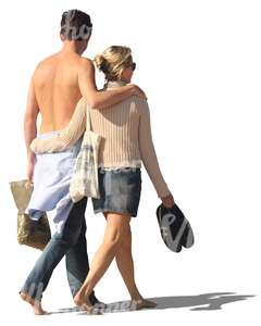 couple walking barefoot arm in arm