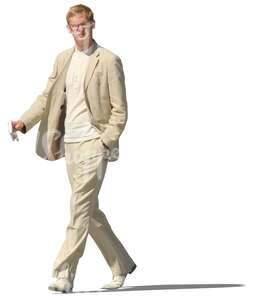 man in a beige suit walking