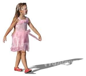 girl in a fancy pink dress walking