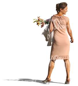 woman in a beige party dress and flowers