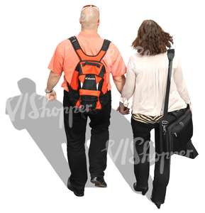 man and woman walking hand in hand