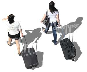 two women with suitcases walking