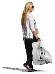 blond woman standing with a huge shopping bag