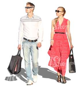couple with shopping bags walking side by side
