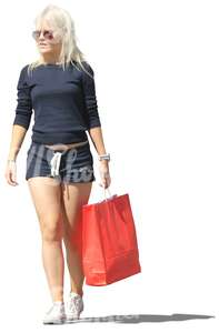 blond woman with a big red shopping bag