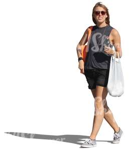 woman with sunglasses and groceries bag