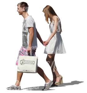 young couple with shopping bags walking hand in hand