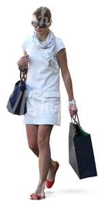 woman walking with a shopping bag in her hand