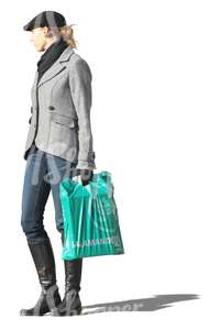 woman standing with a bag in her hand