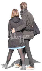 couple in black coats walking arm in arm