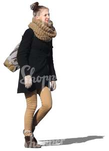 woman with a big scarf walking