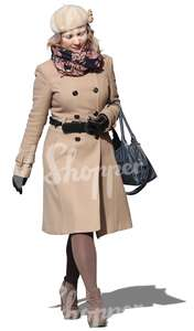 woman with a beige coat walking