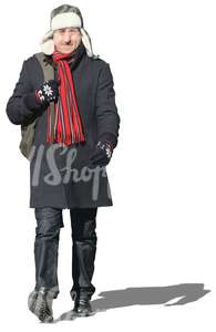 man with a red scarf walking