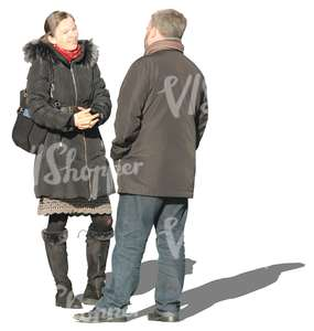 man and woman  talking in wintertime