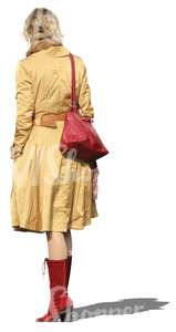 cut out woman in a yellow coat standing