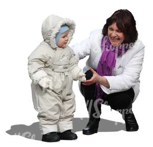 woman playing with a small child in winter