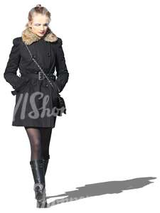 cut out woman in a black coat walking
