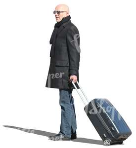 travelling man standing with a suitcase