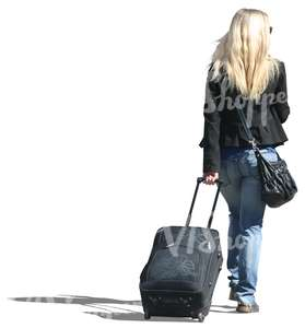 blond woman travelling with a suitcase
