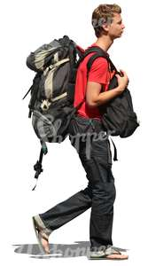 teenage boy travelling with a huge backpack