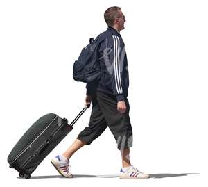 man walking and pulling a suitcase