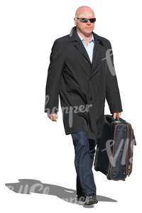 man in a black coat carrying a suitcase