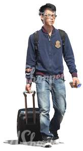 young asian man pulling a suitcase