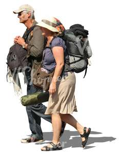 man and woman carrying heavey backpacks