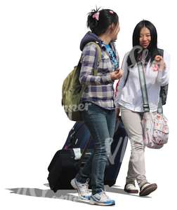 two asian women walking with suitcases