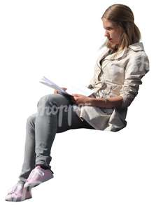 cut out blond woman sitting and reading