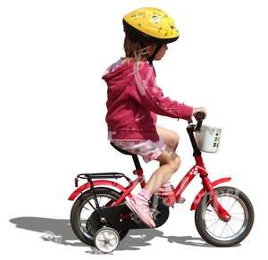 little girl with helmet riding a bike