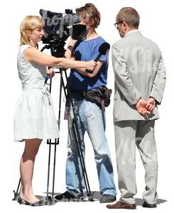 filming group with camera interviewing a man