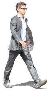 cut out man in a grey suit walking