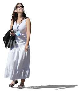 cut out woman in a white dress walking
