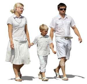 family dressed in white walking hand in hand