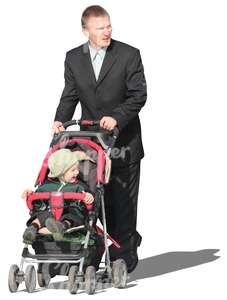 man in a suit pushing a baby stroller